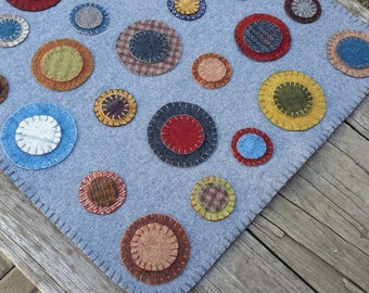 Wool penny rug, wool candle mat
