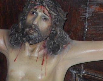 Antique Crucifix with Christ of plaster with glass eyes and mark of Olot. Wooden cross and 1940's.