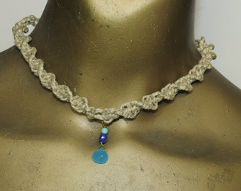 Chalcedony blue quartz, purple pearl, and magnesite gemstones on a spiral-knotted hemp choker necklace. Long ties in back. HCK-975