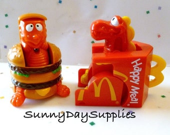 2 Vintage McDonalds Happy Meal Toys,  Dinosaurs, Changeables, McDonald's Big MAC, The Happy Meal BOX, Dinosaur, Transformers, Food Toys