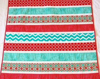 Red and teal strip quilt