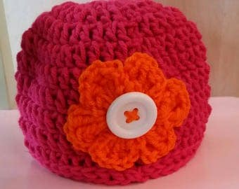 Pink & Orange Beanie Hat with flower, button, crochet, colorful, white, large flower, white, pink, warm, weather, cold, snow, messy bun hat