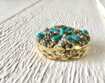 Vintage pill box oval gold metal turquoise stones open filligreed hinged 1960s
