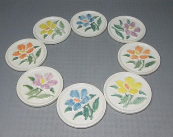 Set of 8 pottery coasters marked Mosaic made in USA ( is this the Mosaic Tile co ? ) flowers