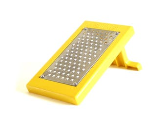 Sunkist Grater / Lemon Zester, Stainless Steel, Yellow Plastic Stand Fold Up