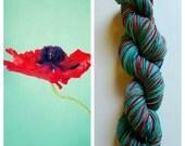 Poppy field: handdyed self striping Merino sock yarn by Star Fiber Studio