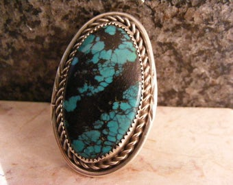 Stunning Signed Extra Large Native American Spider Web Turquoise Ring in Sterling.....  Lot 4815