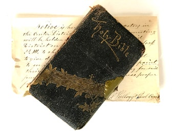 Antique Bible leather covered, embossed with a brass clasp