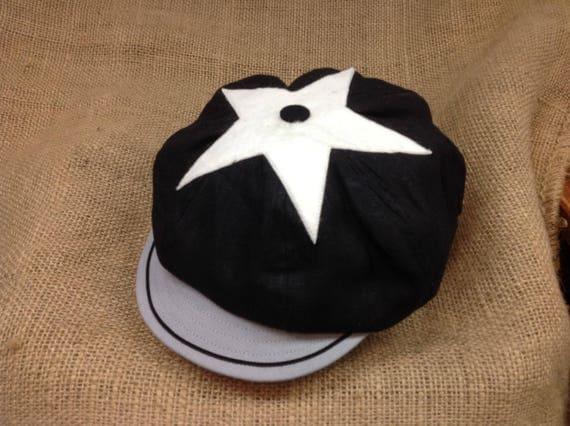 "Fulton Mules Vintage Base Ball club cap, black wool flannel flat top baggy cap with felt star on top, 2"" grey visor with soutach trim."