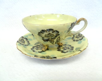 Norcrest Teacup and Saucer, Japan, Blue Flowers on Yellow and Aqua Background, Tri-footed