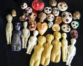 Lot of Older Clay faces and Dolls