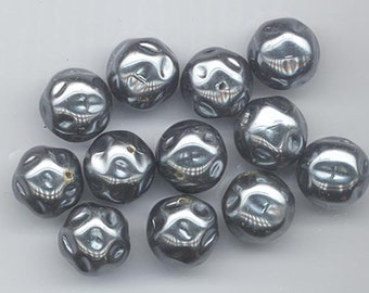 Thirteen absolutely gorgeous vintage glass pearls with baroque shape - metallic silvery dark grey -