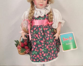 Vintage porcelain pigtailed blond hair blue eyed doll 15 inch strawberry dress and strawberry basket Flower Girl Exclusive used