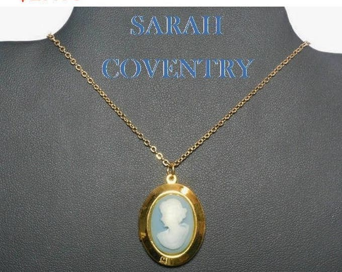 SALE Sarah Coventry cameo locket, pendant cameo double locket, white silhouette on light blue background, gold tone chain and casing.