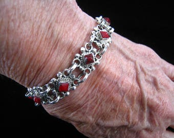 """Sterling Silver & Red Coral Cabochon Mexican Made Link Bracelet.  Hidden Box Clasp Closure.  TL-118 Taxco Code.  Clasped Length = 7.5"""""""