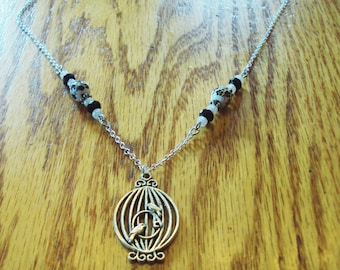 Pewter Bird Cage Necklace with beaded accents in black and white on silver plated chain