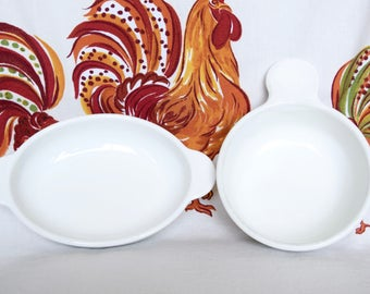 Two vintage Corning Ware dishes...round grab it dish...small oval casserole.