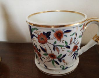 Antique  coffee can  with beautiful ornate pattern