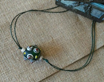 AWESOME  ancient Chinese glass bead on leather cord.