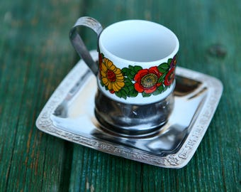 Retro Italian espresso cups with flower design and saucers