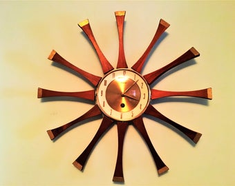 Handsome STARBURST CLOCK by FORESTVILLE key wind German movement wood and brass mid century classic