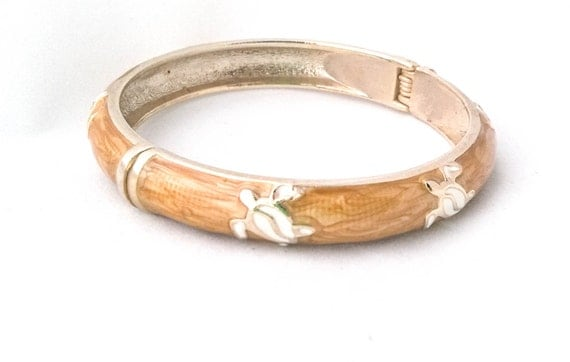 Vintage gold plated hinged bangle bracelet with golden tan marbled enamel and white enamel turtles