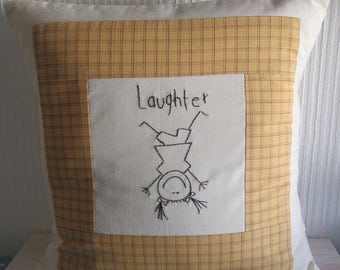 """Cushion with hand embroidered word """"laughter and girl""""  for a child or baby room"""