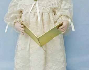 Caroler Angelica porcelain doll