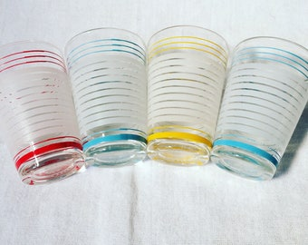 Four beautiful pastel French shot glasses