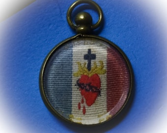 Victorian sacred heart stitched on ribbon under glass in gf locket fob religious jewelry embroidery stitch hand  work Red, White & Blue LA