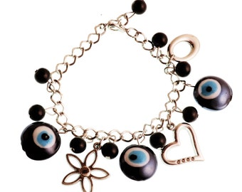 Brass bracelet with glass evil eye