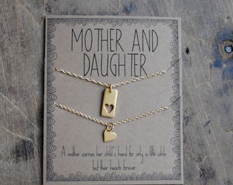 Mother Daughter Necklace Set  .  a mother carries her childs hand for a little while  .  mother of the bride  set