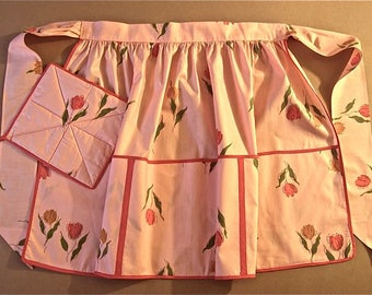 Vintage apron with matching potholder, 1960's, pink polished cotton, floral print, tulips and leaves, new, unused with tag, very charming.