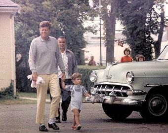 John Kennedy , Kennedy out with John Jr in 1963