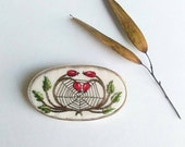 Hand embroidered rosehip with spiderweb sterling silver brooch