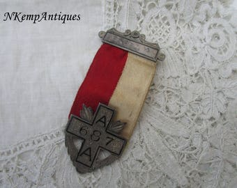 Antique medal with ribbon