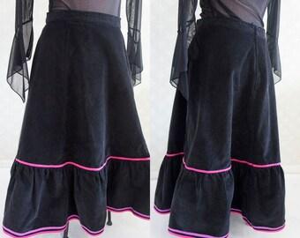 Black corduroy flared vintage skirt. 80s clothing. Black corduroy with violet an pink border.