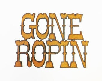 Gone Ropin sign made out of rusted recycled rustic rusty metal