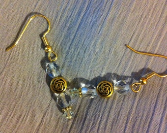 Light blue and gold plated pierced earrings with Celtic knots on gold plated beads.