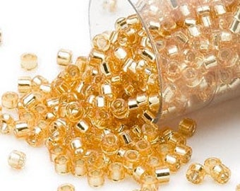 Delica-Silver Lined Gold 7.2 grams  (DB42)  11/0 Miyuki Cylinder Seed Beads