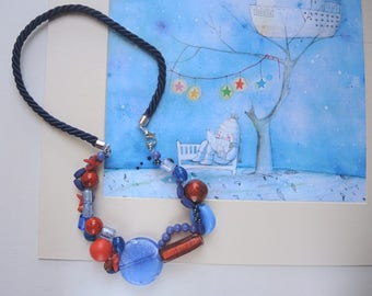 Necklace of beads of glass, ceramics and woodwork, in the colors Blue and orange