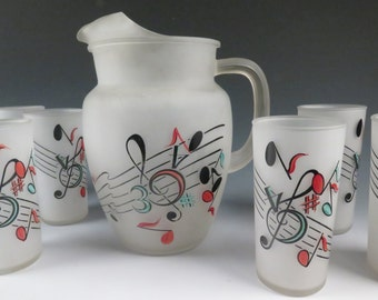 Hazel Atlas  pitcher and six glasses with music notes