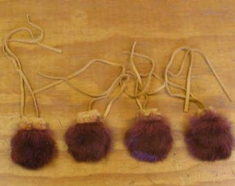 "4 Small Rust Color Rabbit Fur Bags. Measures 4 1/2"" long, 3 1/2"" wide."