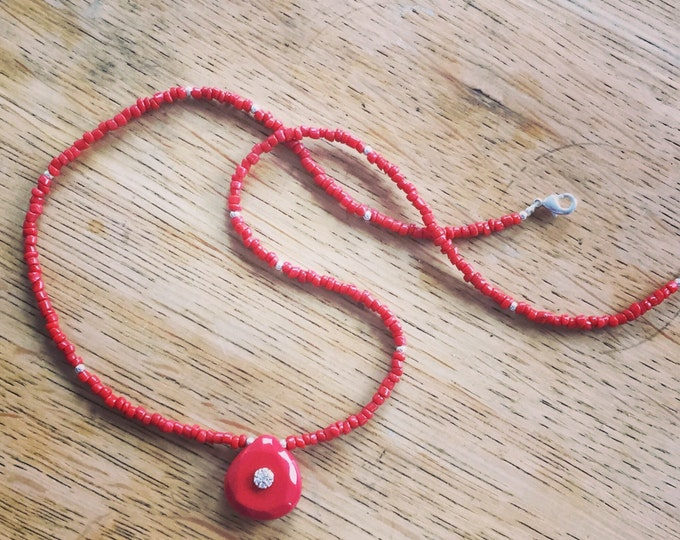 Necklace with a turquoise pendant and coral beads