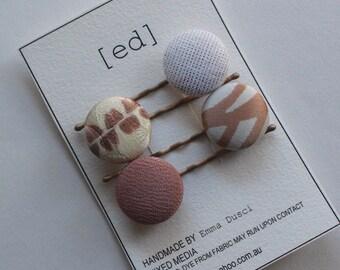 H AN D M A D E  Fabric covered button hair clip.