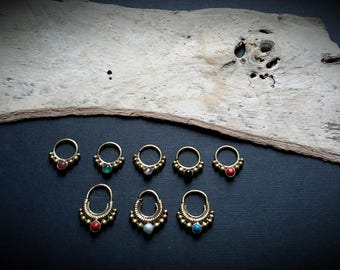 septum/piercing/earring with a stone in brass