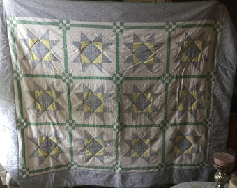 Blue, yellow and white handmade quilt