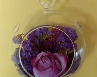 Hanging glass glibe with preserved rose and statice flower