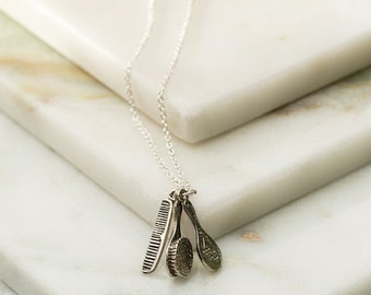 Vintage inspired vanity set charm necklace featuring a hairbrush, comb and mirror