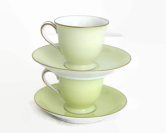 2 Noritake cups and saucers in shades of a yellowish green color, gilt edges on sups and saucers, demitasse, made in Japan, 1940s